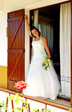 Bride at window. Bride leaving parent´s home . Portrait of a bride outside window Royalty Free Stock Images