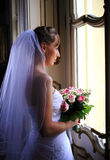 Bride at window Royalty Free Stock Images