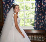 The bride at a window Stock Photo