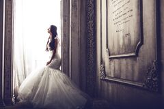 Bride at window