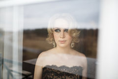 The bride through a window Royalty Free Stock Image