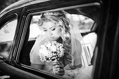 Bride in a window of a wedding retro of the car Royalty Free Stock Photography