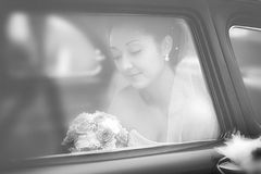 Bride in a window of a wedding retro of the car Royalty Free Stock Images