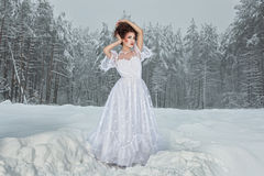 Bride in winter forest. stock photos