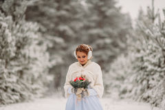 Bride in the winter forest Stock Photo