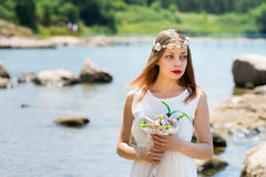 Bride With Wedding Crown And Bouquet Of Seashels Stock Photos