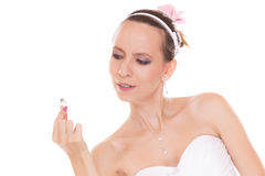 Bride woman admiring looking at engagement ring. Royalty Free Stock Images