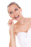 Bride woman biting engagement ring. Stock Images