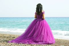 Bride woman in elegant dress on the beach