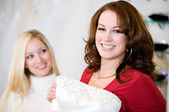 Bride: Woman Finds Gown She Likes. Series with a women and her bridal gown. Shopping in store, wearing, eating cake, etc stock image