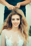 Bride woman with hairdresser Royalty Free Stock Photography
