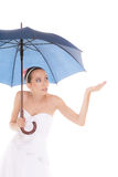 Bride woman hiding taking cover under umbrella Royalty Free Stock Images