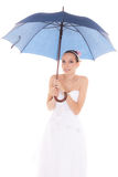 Bride woman hiding taking cover under umbrella Stock Photo