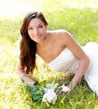 Bride woman lying in park grass Royalty Free Stock Photography