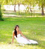 Bride woman sitting in park green grass Royalty Free Stock Images
