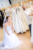 Bride: Woman Wearing Gown and Laughing At Friend Royalty Free Stock Images