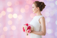 Bride or woman in white dress with flower bunch Stock Photography