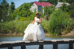 Bride on Wooden Bridge. Over river Royalty Free Stock Photo