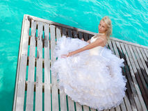 Bride on a wooden platform over the sea Royalty Free Stock Image