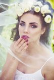 Bride with wreath of buttercup and veil on head Royalty Free Stock Images