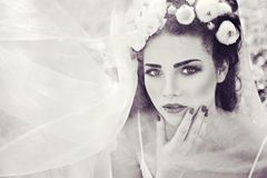 Bride with wreath of natural buttercup on head and veil retro Stock Photography