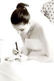 Bride. Writing names under her shoe Royalty Free Stock Photos