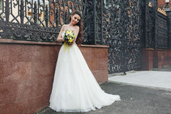 Bride with yellow bouquet Royalty Free Stock Photography