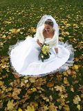 Bride in Yelow Leaves. Young beautiful bride in yellow leaves smiling Stock Images