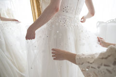 Bride that you are shall we put the dress Stock Photo