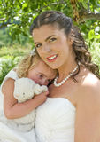 Bride and Young Bridesmaid Royalty Free Stock Images