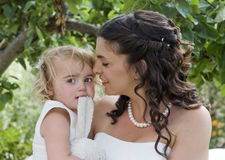 Bride and Young Bridesmaid Stock Images