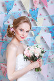 Bride.Young fashion model with  make up, ,curly hair, flowers in hair. Bride fashion. Jewelry and Beauty. Woman in white dress Stock Image