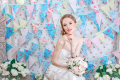 Bride.Young fashion model with  make up, ,curly hair, flowers in hair. Bride fashion. Jewelry and Beauty. Woman in white dress Stock Photo