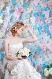 Bride.Young fashion model with  make up, ,curly hair, flowers in hair. Bride fashion. Jewelry and Beauty. Woman in white dress Royalty Free Stock Photos