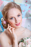 Bride.Young fashion model with  make up, ,curly hair, flowers in hair. Bride fashion. Jewelry and Beauty. Woman in white dress Royalty Free Stock Images