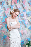 Bride.Young fashion model with perfect skin and make up, flowers in hair. Beautiful woman with makeup and hairstyle in bedroom. Happy Bride waiting groom Royalty Free Stock Images