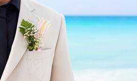 Bridegroom. Groom's wedding suit with boutonniere made of flower and green leaves Stock Image