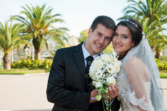Bridegroom and bride. On background of the green palms Stock Photography