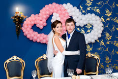 Bridegroom and bride at banquet Royalty Free Stock Photography
