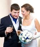 Bridegroom and bride with champagne Stock Images