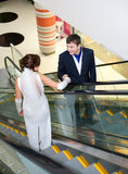 Bridegroom and bride on escalator Royalty Free Stock Photography