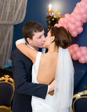 Bridegroom and bride kiss Royalty Free Stock Image