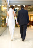 Bridegroom and bride walk in mall Royalty Free Stock Images