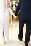 Bridegroom and bride walk in mall Stock Image