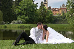 Bridegroom and bride on the wedding in park. Bridegroom and beautiful bride in white on the wedding in park stock photo