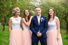 Bridegroom with bridesmaids Royalty Free Stock Photo