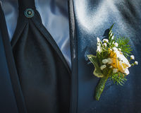Bridegroom dress details. Details bridegroom dress. blue satin suit, blue shirt, cufflinks inlaid with stones in a tie, a jacket fastened with a rose floral royalty free stock photos