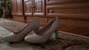 The bridegroom is dressing for wedding. Accessories for the bride, jacket, shoes, cufflinks. A groomed young man dressed. The bride is dressing for wedding stock footage