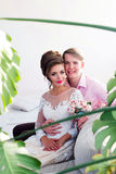 The bridegroom embraces the bride. The groom in a pink shirt takes the bride Royalty Free Stock Images