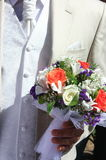Bridegroom holding  bouquet Stock Photography